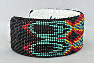a3274 Yonavea bkacj/multi world and feather cut bead cuff, side view